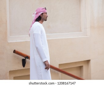 Dubai, UAE - March 25, 2018: Man dressed in traditional Arabian cloth kandora looks forward in Madinat Jumeirah district