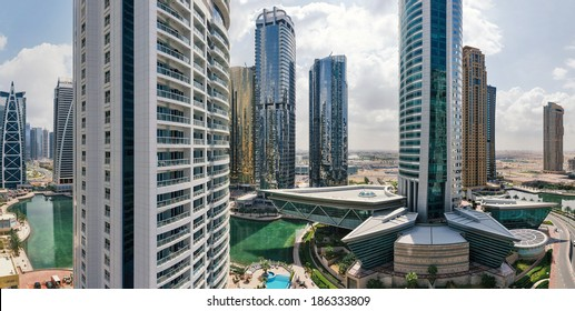 DUBAI, UAE - MARCH 27, 2014: Buildings of Jumeirah Lakes Towers. The JLT is a large development which consists of 79 towers being constructed along the edges of 4 artificial lakes.