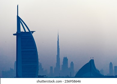 DUBAI, UAE - MARCH 3: View of the luxury hotel Burj Al Arab, Burj Khalifa and Jumeirah Beach Hotel at sunrise, on March 3, 2013  in Dubai, United Arab Emirates.