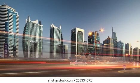 DUBAI, UAE - MARCH 5: View of Sheikh Zayed Road skyscrapers in Dubai at sunset, UAE on March 5, 2013. On The Sheikh Zayed Road is located most of Dubai's skyscrapers.