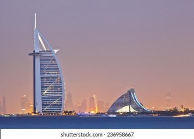 DUBAI, UAE - MARCH 7: View of the luxury hotel Burj Al Arab and Jumeirah Beach Hotel at sunset, on March 7, 2013  in Dubai, United Arab Emirates.