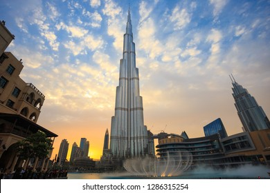 Dubai, UAE - May 03, 2018: Skyline with beautiful clouds and colors after sunset.  Burj Khalifa lake during the Dubai Fountain's 18:30 show.