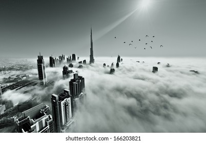 DUBAI, UAE - MAY 12: Burj khalifa, the highest building in the world, Downtown is covered by early morning fog on May 12,2013 in Dubai, UAE