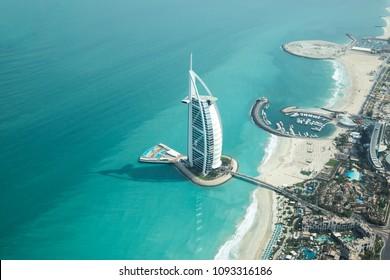 Dubai, UAE - May 18, 2018: Aerial view of Burj Al Arab luxury hotel on the coast of Persian Gulf on a clear sunny day.