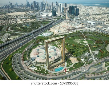 Dubai, UAE - May 18, 2018: Golden Dubai Frame viewed from above on a sunny day on the background of Dubai Downtown.