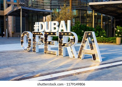 DUBAI, UAE - May 18, 2018: Hashtag Dubai Opera iconic sign near Dubai Opera downtown district.