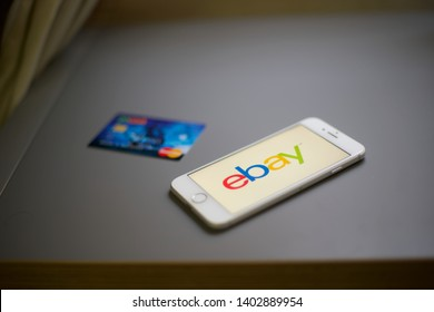 Dubai - UAE, may 20:  Buying online from eBay by blue credit card,  eBay application on the screen. eBay is one of the largest online shopping websites in the world.