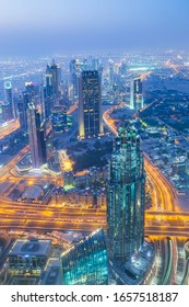 Dubai, UAE - May 2015: View of high rise buildings during night sky from the observation deck of the world's Tallest building, Burj Khalifa