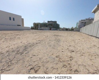 Dubai UAE - May 2019: Empty reclamation, compact land. Land plot for sales and real estate development project concept background.