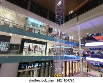 Dubai UAE - May 2019: People inside the Grand Atrium inside Dubai Mall. Interior View Dubal Mall shopping mall. world's largest shopping mall based on total area