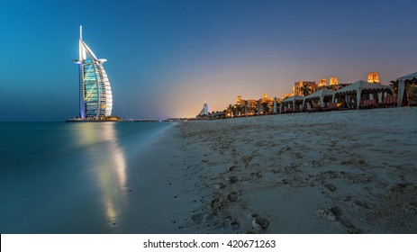 Dubai, UAE - MAY 28: Burj Al Arab Hotel on May 28 , 2011 in Dubai with Blue Hour Sunset with Luxury Beach View. Burj Al Arab is 7 Stars Hotel built on an artificial island in front of Jumeirah beach.