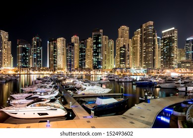 DUBAI, UAE - MAY 3: Night view at modern skyscrapers in Dubai Marina on May 3rd 2013 in Dubai. Dubai Marina - artificial canal city, carved along a stretch of Persian Gulf shoreline.
