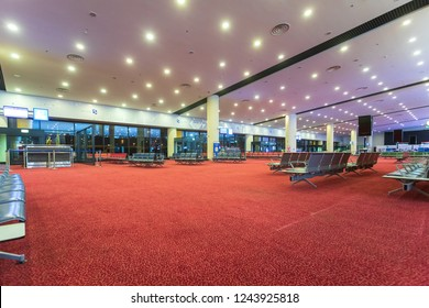 DUBAI, UAE - NOV 13, 2018: Al Maktoum International Airport - World's Largest Airport. Empty airport departure lounge with empty passenger seats at terminal airport – night time