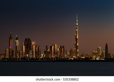 DUBAI, UAE - NOV 27: Skyline view of Dubai from Jumeirah Beach showing the Sheikh Zayed Road and Burj Khalifa on Nov 27, 2014 in Dubai, UAE. Burj Khalifa, the tallest skyscraper in the world at 829.8m