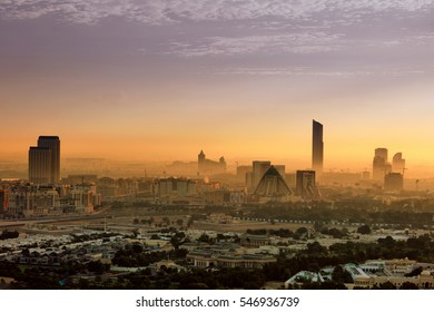 DUBAI, UAE - NOV 28: The hazy Dubai skyline over the Wafi Pyramids just after dawn in Dubai, UAE on Nov 28, 2015, UAE. Dubai was just a desert 30 years ago