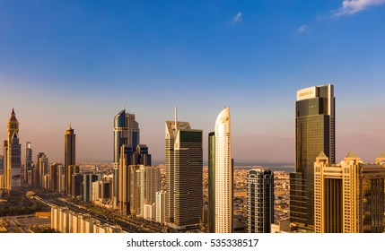DUBAI, UAE - NOV 28: A skyline view of Dubai showing the buildings of Sheikh Zayed Road including Blue Tower, Chelsea Tower, Conrad, Fairmont and DIFC on Nov 28, 2015 in Dubai, UAE