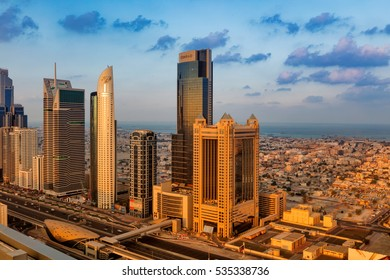 DUBAI, UAE - NOV 28: A skyline view of Dubai showing the buildings of Sheikh Zayed Road including Blue Tower, Chelsea Tower, Conrad, Fairmont and DIFC on Nov 28, 2015 in Dubai, UAE