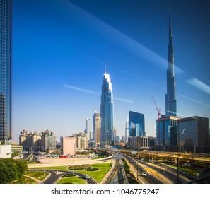 Dubai, UAE - November 03, 2017: Dubai downtown view through window. Burj Khalifa on sunny day.
