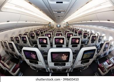 Dubai, UAE - NOVEMBER 08, 2015: Qatar Airways Airbus A350 economy class seats. Oryx In flight entertainment system. Economy class cabin interior. 3-3-3 seat layout. Qatar Airways travel.
