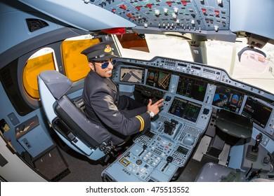 Dubai, UAE - NOVEMBER 08, 2015: Airline pilot posing in the cockpit. Qatar Airways Airbus A350 cockpit. Airbus A350 interior. Modern airplane. Aircraft cockpit. Qatar Airways.
