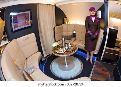 Dubai, UAE - NOVEMBER 09, 2015: Etihad Airways Airbus A380 cabin crew member. Etihad flight attendant. Etihad Airbus A380 upper deck lounge The Lobby. Business class travel. Travel with Etihad.