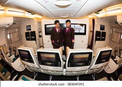 Dubai, UAE - NOVEMBER 09, 2015: Etihad Airways Airbus A380 cabin crew members, stewardesses. Flight attendants. Aircraft economy class. Airbus A380 interior on November 09, 2015 in Dubai