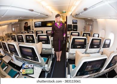 Dubai, UAE - NOVEMBER 09, 2015: Etihad Airways Airbus A380 stewardess, flight attendant. Etihad airways airplane.Economy class seats. Etihad stewardess, cabin crew member on November 09, 2015 in Dubai
