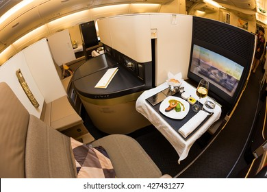 Dubai, UAE - NOVEMBER 09, 2015: Etihad Airways Airbus A380 business class luxury seats. Etihad airways business class. Etihad Airline on board dining,meals,food on November 09, 2015 in Dubai
