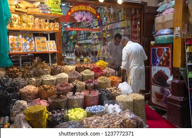 DUBAI, UAE - November 09, 2018: Merchant selling spices to client in Dubai spice souk in Deira district. Traditional spices shop in old town