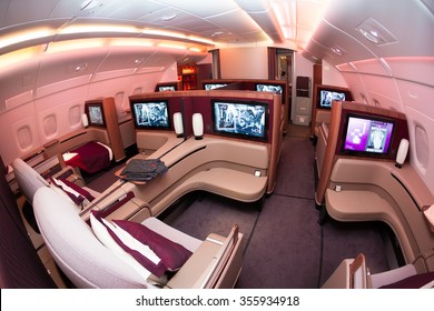 Dubai, UAE - NOVEMBER 10, 2015: Qatar Airways Airbus A380 first class luxury seats. Qatar Airways ORYX inflight entertainment IFE. Business class travelling. Airline first class suit.