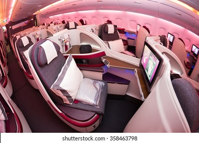Dubai, UAE - NOVEMBER 10, 2015: Qatar Airways Airbus A380 business class luxury seats. Airbus A380 interior. Business class travel. Qatar Airways business class. ORYX In flight entertainment system.