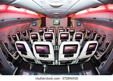 Dubai, UAE - NOVEMBER 10, 2015: Qatar Airways Airbus A380 economy class seats. Qatar Airways ORYX in flight entertainment sytem. Airline IFE. Airbus A380 interior.