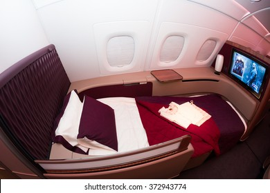Dubai, UAE - NOVEMBER 10, 2015: Qatar Airways Airbus A380 first class luxury seat. First class flat bed seat. Qatar Airways first class.Reclined flat bed first class seat on November 10, 2015 in Dubai