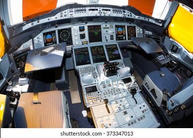 Dubai, UAE - NOVEMBER 10, 2015: Qatar Airways Airbus A380 cockpit, pilot seats. Airbus A380 displays, instruments. Throttles. Airbus side-sticks. Airbus A380 interior.