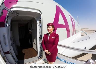 Dubai, UAE - NOVEMBER 10, 2015: Qatar Airways Airbus A380 cabin crew member, flight attendant. Qatar Airways Welcome aboard. Airbus A380. Travel with Qatar Airways. Stewardess dress.