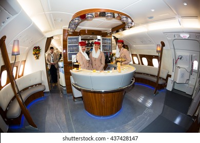 Dubai, UAE - NOVEMBER 10, 2015: Emirates Airbus A380 onboard lounge. Emirates first class, business class travel. Emirates flight attendants. Emirates cabin crew members. Emirates A380 bar lounge.