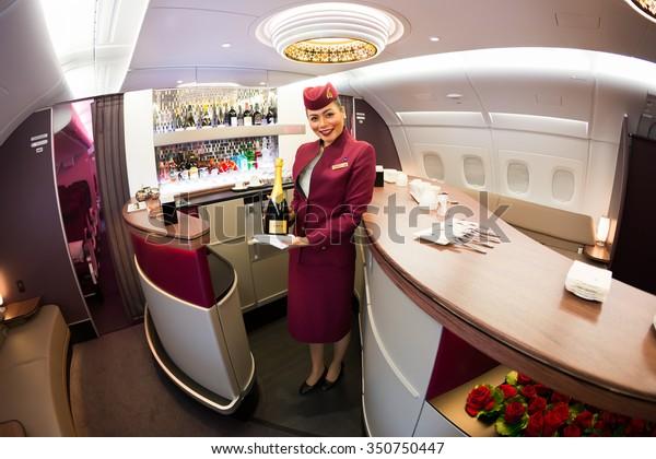 Dubai, UAE - NOVEMBER 10, 2015: Qatar Airways Airbus A380 cabin crew member, flight attendant. Qatar Airways Business class, first class. Qatar Airways lounge bar. Business class travel.