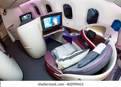 Dubai, UAE - NOVEMBER 11, 2015: Qatar Airways Boeing 787 Dreamliner business class seats. Qatar Airways business class cabin on November 11, 2015 in Dubai