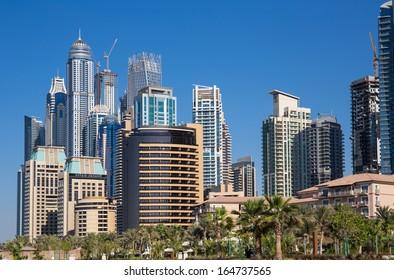 DUBAI, UAE - NOVEMBER 11: Modern buildings in Dubai Marina, on November 11, 2013, Dubai, UAE. In the city of artificial channel length of 3 kilometers along the Persian Gulf.