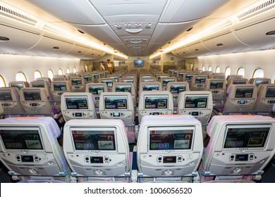 Dubai, UAE - NOVEMBER 12, 2017: Emirates economy class seats. Airbus A380 interior. Emirates airline travel. Inflight Entertainment IFE screen.