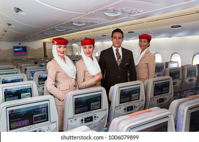 Dubai, UAE - NOVEMBER 12, 2017: Emirates flight attendants. Airbus A380 travel. Stewardess dress. Flight attendant portrait. Emirates airline.
