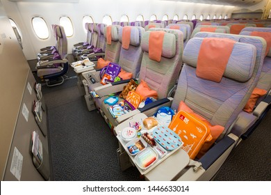Dubai, UAE - NOVEMBER 12, 2017: Travel with kids. Flying with children. Emirates Airline Airbus A380. Children travel with Emirates, family travel, on board amenities for kids . UAE airline.