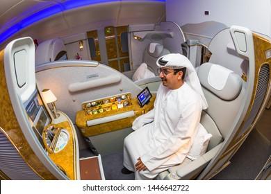 Dubai, UAE - NOVEMBER 12, 2017: Man travelling first class. Emirates first class suite. Luxury business class suite. Luxury travel. Arab sheikh. Rich man.