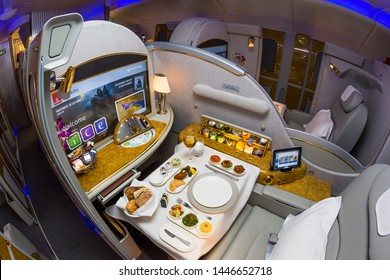Dubai, UAE - NOVEMBER 12, 2017: Emirates first class travel. Airbus A380. Exploring the world with Emirates. Luxury first class suite. Luxury Emirates travel.