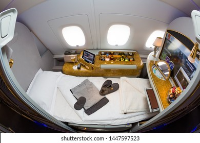 Dubai, UAE - NOVEMBER 12, 2017: Emirates first class travel. Airbus A380. Exploring the world with Emirates. Luxury first class suite. Luxury travel.