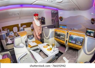 Dubai, UAE - NOVEMBER 12, 2017: Emirates Airline flight attendant. Emirates business class. Airplane food. Stewardess dress. Flight attendant portrait. Emirates airline travel. Onboard dining.