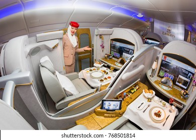 Dubai, UAE - NOVEMBER 12, 2017: Emirates Airline flight attendant. Emirates first class. Onboard food, dining. Luxury travel. Airbus A380. First class suite.