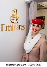 Dubai, UAE - NOVEMBER 12, 2017: Emirates beautiful flight attendant. Emirates logo. Traveling with Emirates. Airbus A380. Dubai travel. Leading world's airline.