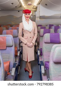 Dubai, UAE - NOVEMBER 12, 2017: Emirates airline beautiful flight attendant. Emirates airline flight. Airbus A380 interior. Emirates stewardess uniform.