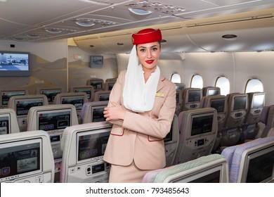 Dubai, UAE - NOVEMBER 12, 2017: Emirates beautiful flight attendant. Emirates Airbus A380 travel. Stewardess dress. Flight attendant portrait. Dubai travel.